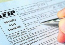 Fernández promulgó la ley de modificación al impuesto a las Ganancias